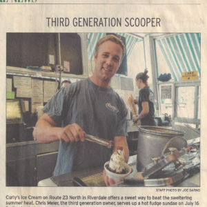 Chris Meier, third generation owner serves up a hot fudge sundae
